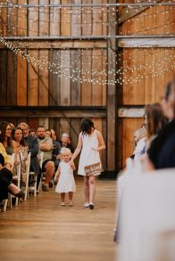 Little Kate being helped down the aisle by Aubri.